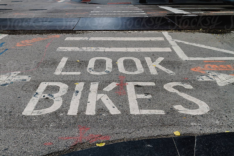 bike crossing sign in urban setting by Jess Lewis for Stocksy United