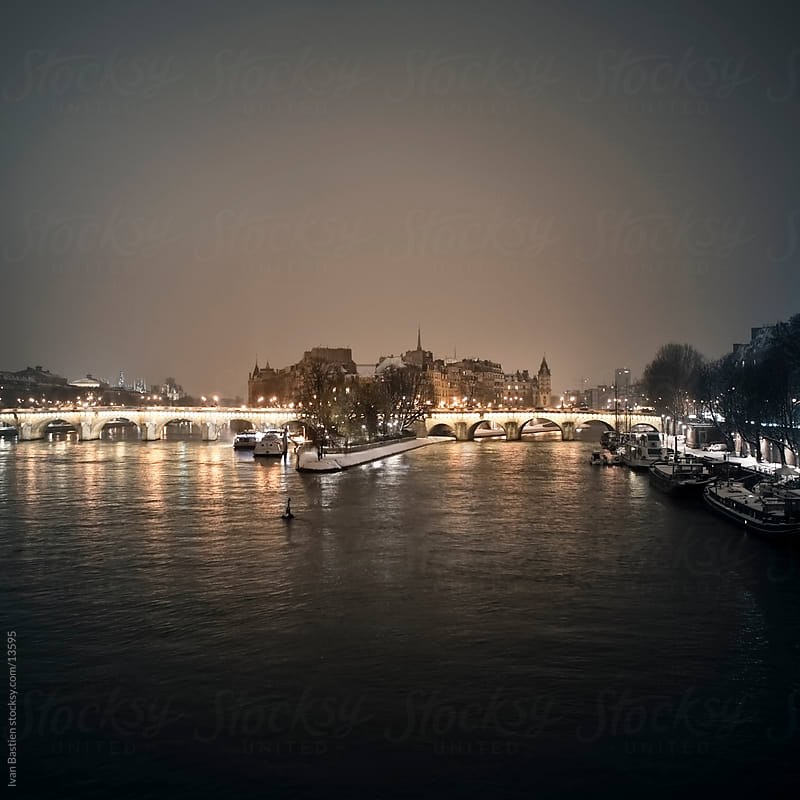 Ile de la Cite in Paris at night by Ivan Bastien for Stocksy United