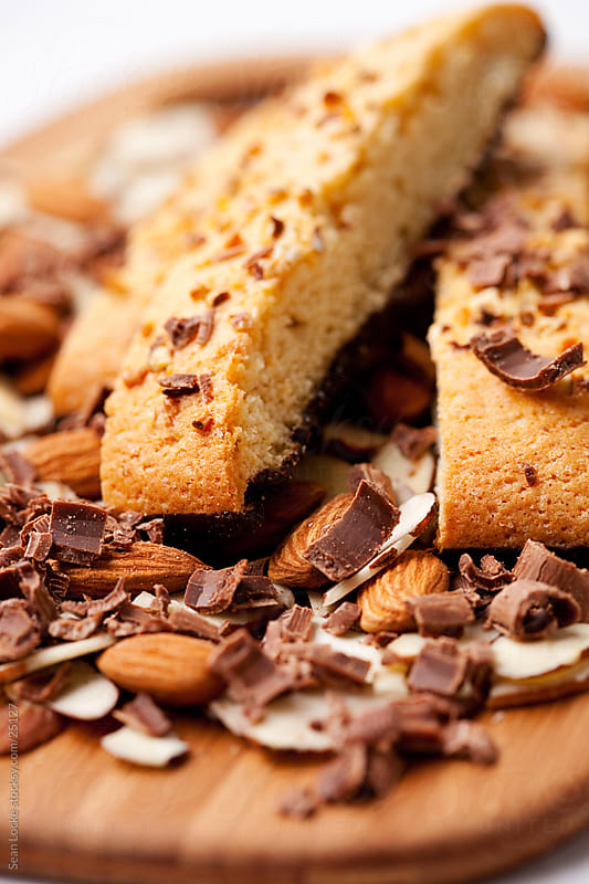 Biscotti: Close Up of Almond Biscotti and Chocolate by Sean Locke for Stocksy United