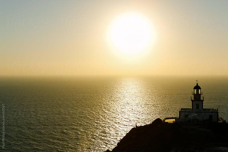 Akrotiri lighthouse at sunset, Santorini, Greece by Paul Phillips for Stocksy United