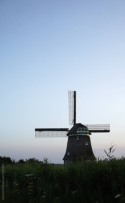 Old Dutch windmill at sunset by Marcel for Stocksy United