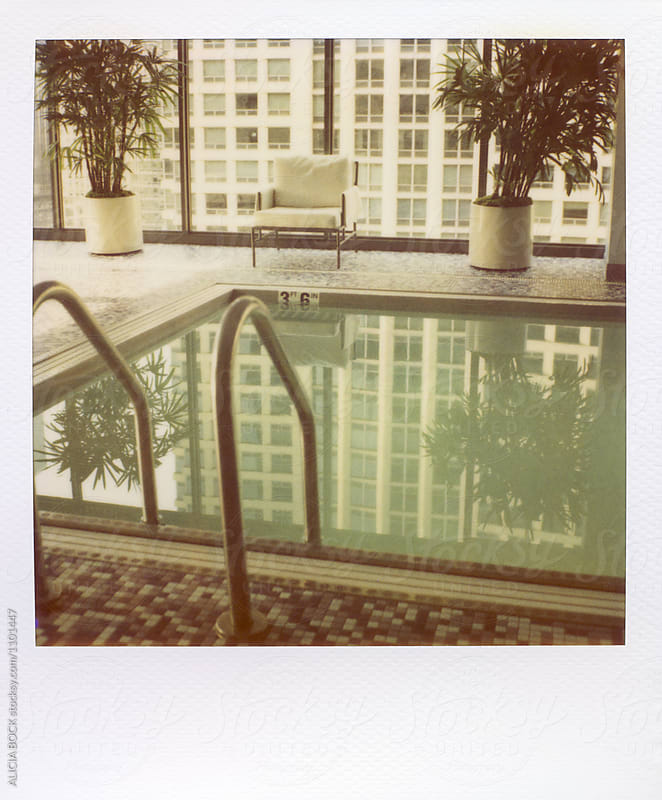 A Rooftop Swimming Pool Photographed With Expired Polaroid Film by ALICIA BOCK for Stocksy United