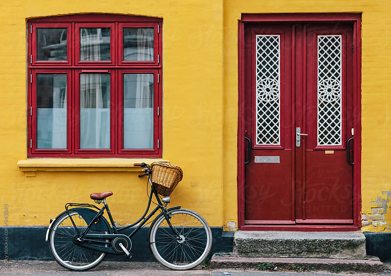 Bike parked near the yellow house by Zocky for Stocksy United