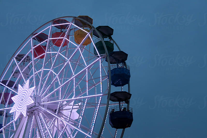 Ferris wheel in Barcelona by Bisual Studio for Stocksy United