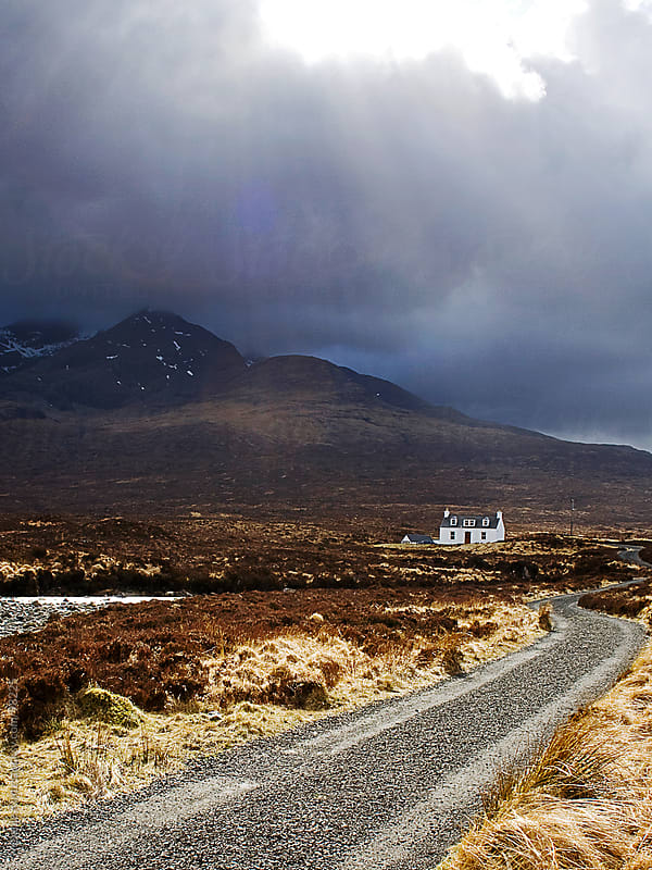 Mount Cullin in Scotland  with dramatic light by Melanie Kintz for Stocksy United
