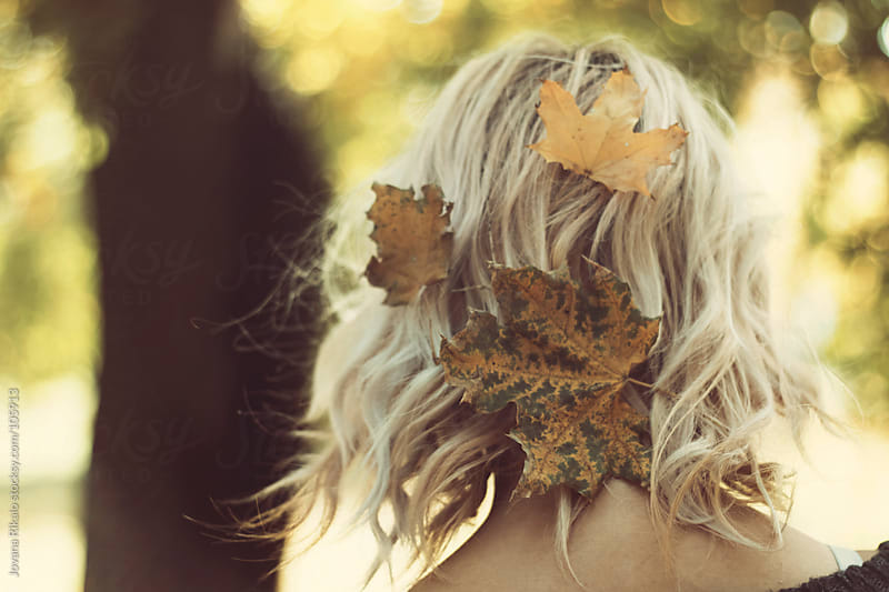 Autumn leaves in girl's hair by Jovana Rikalo for Stocksy United
