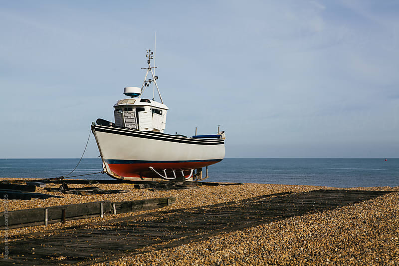 Fishing boat on an empty beach, Kent, UK. by kkgas for Stocksy United