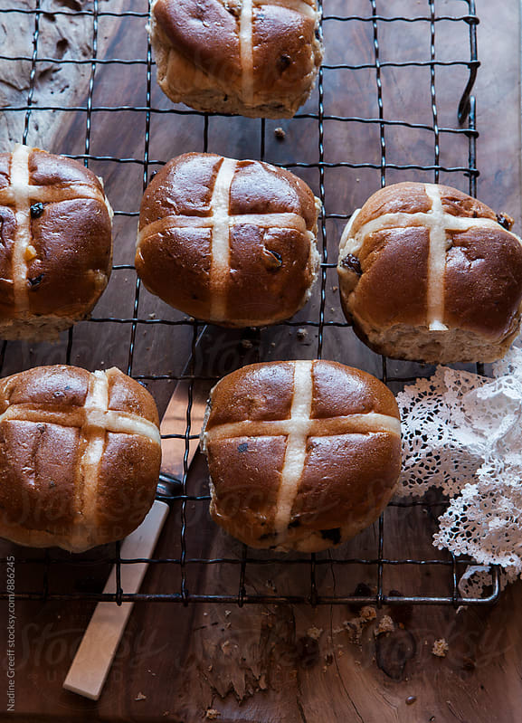 Baked small cakes hot cross buns for Easter holidays by Nadine Greeff for Stocksy United