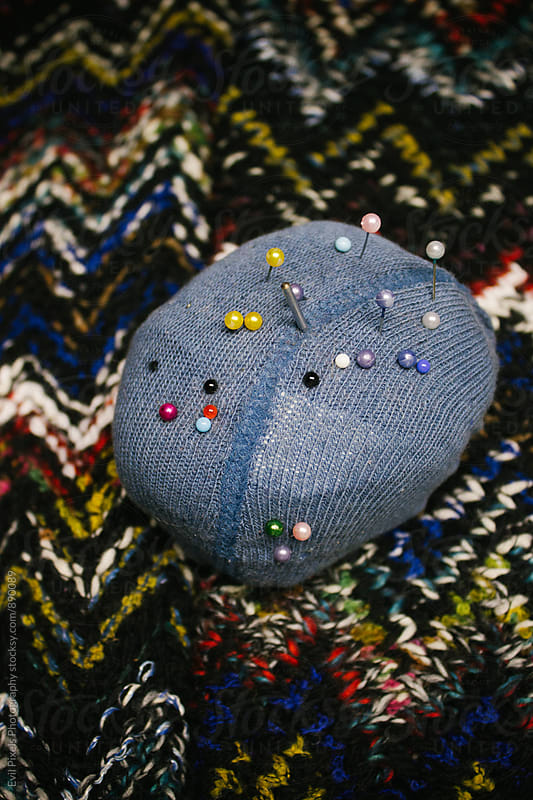Pin cushion on fabric by Branislava Živić for Stocksy United