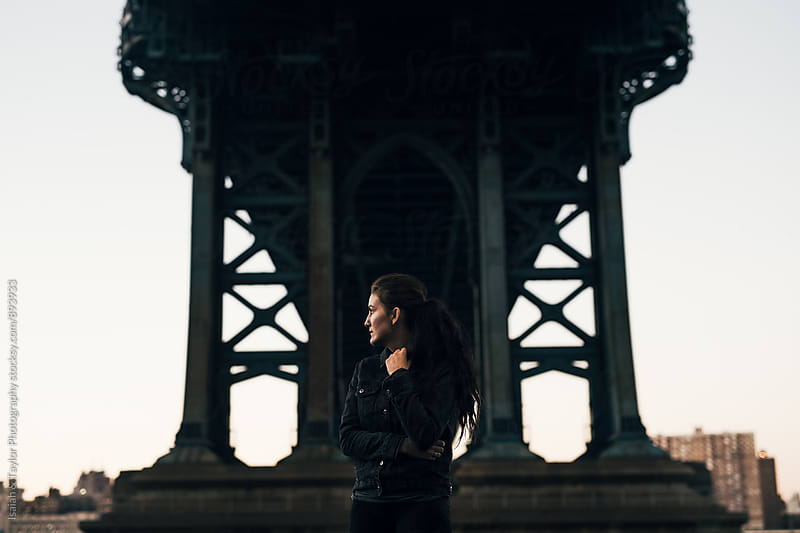 Young Woman Under Bridge by Isaiah & Taylor Photography for Stocksy United