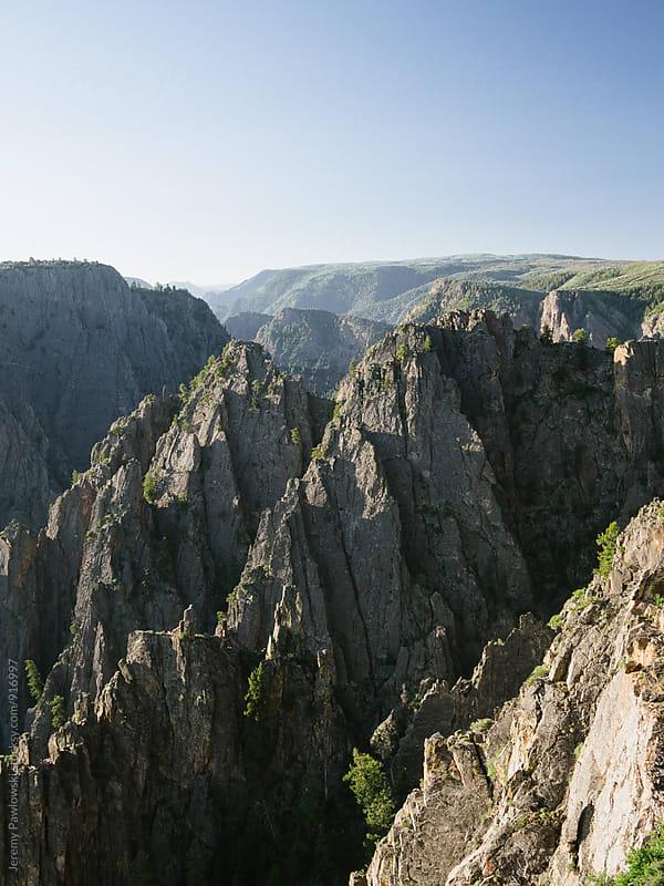 Granite canyon in Colorado with blue sky by Jeremy Pawlowski for Stocksy United