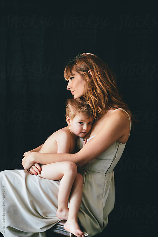 Mother serenely holding her son by Ania Boniecka for Stocksy United