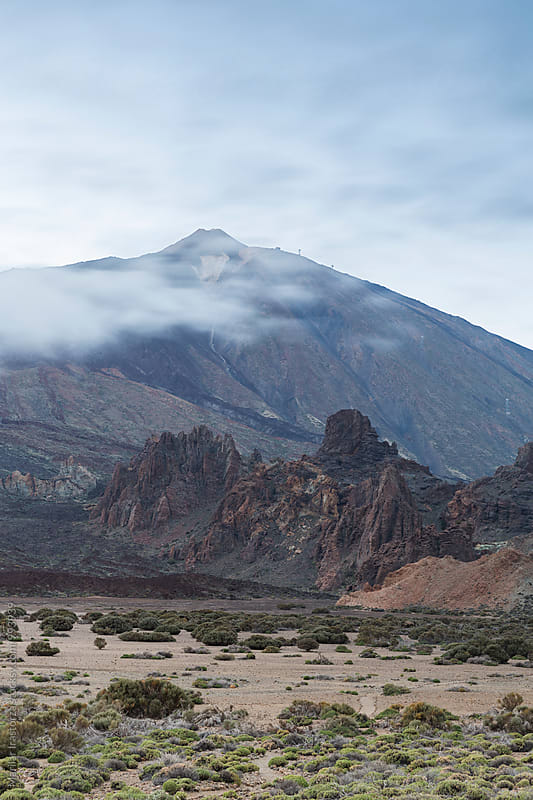Volcanic landscape with Teide peak covered by clouds by Marilar Irastorza for Stocksy United