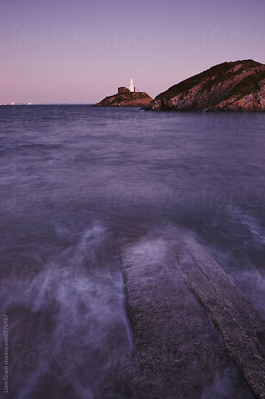 Lighthouse at dusk. Mumbles, Wales, UK. by Liam Grant for Stocksy United