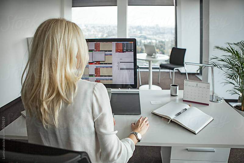 Businesswoman Working at Her Computer by Lumina for Stocksy United