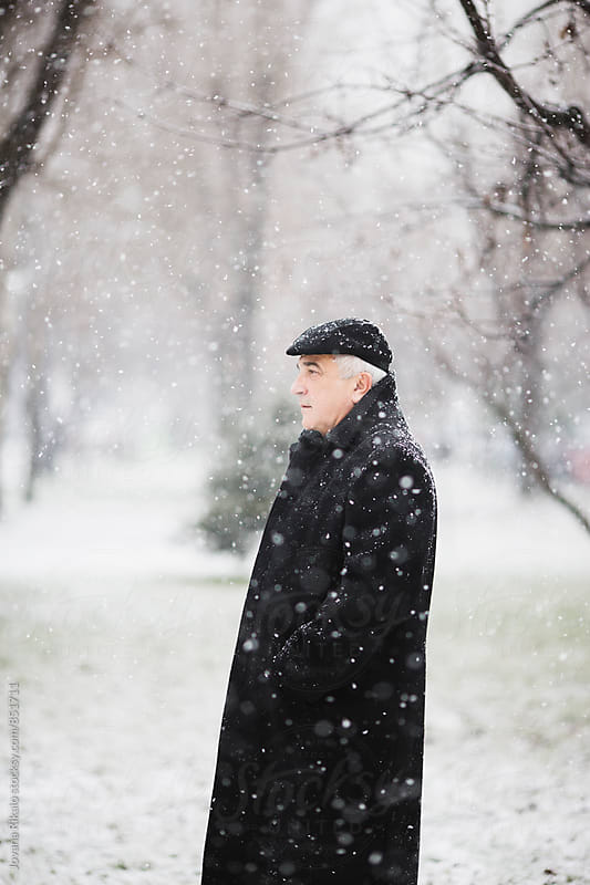Portrait Of An Old Man Outdoors In Snowfall by Jovana Rikalo for Stocksy United