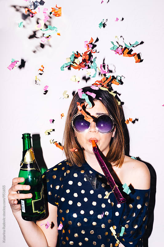 Funny Party Girl Having Champagne by Katarina Radovic for Stocksy United