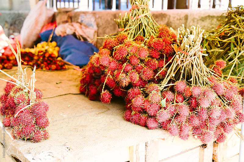 Lychees being sold off a makeshift market stall by Helen Rushbrook for Stocksy United