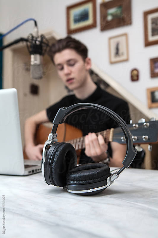 Teenager recording music at home by kkgas for Stocksy United