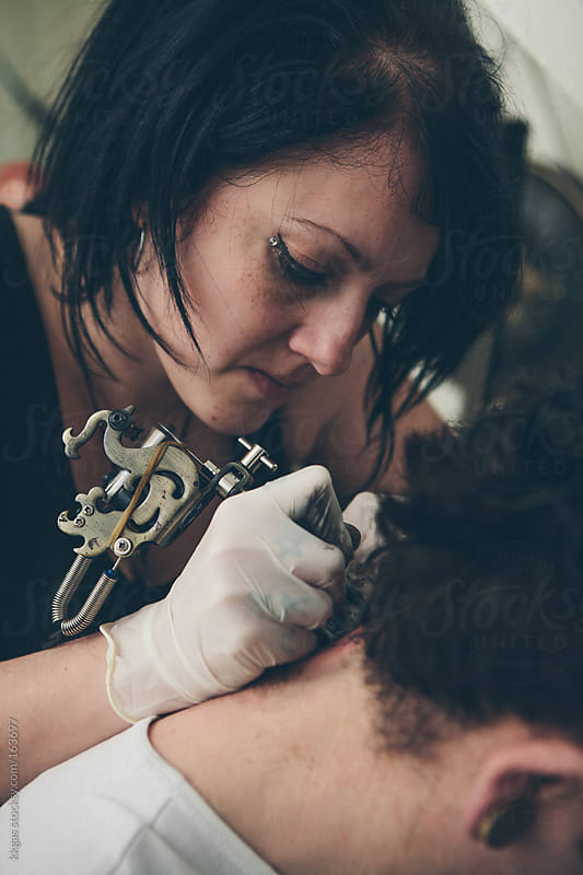 tattoo artist and customer by kkgas for Stocksy United