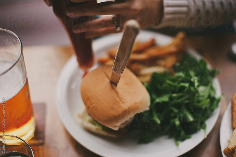 Burgers and fries for lunch by Daring Wanderer for Stocksy United