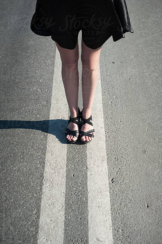 Female legs on a road by Milles Studio for Stocksy United