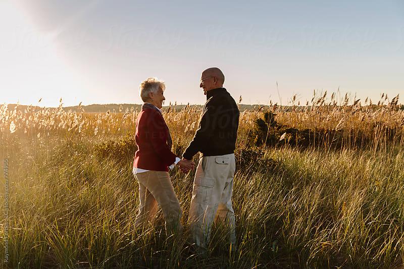 Senior Couple on Autumn Walk by Raymond Forbes LLC for Stocksy United