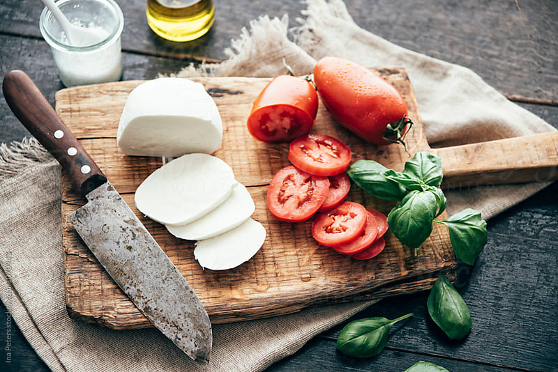 Food: Ingredients for caprese,mozzarella di buffala and san marzano tomato by Ina Peters for Stocksy United