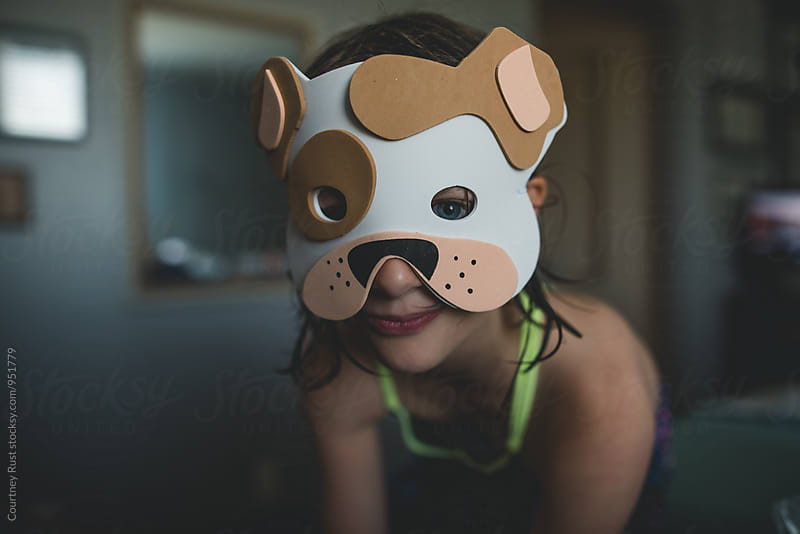 playing make believe in a Bulldog mask  by Courtney Rust for Stocksy United