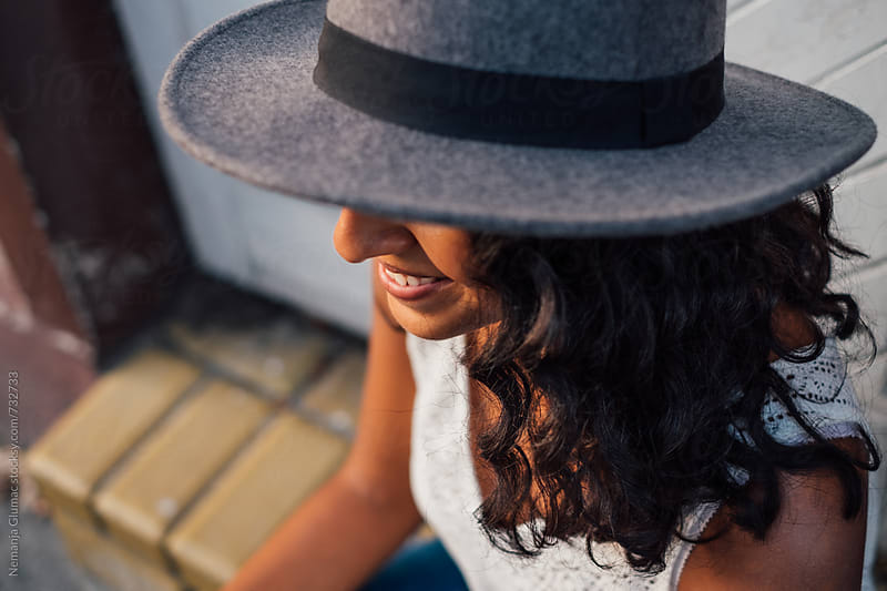 Happy Bolivian Teen With Stylish Hat by Nemanja Glumac for Stocksy United