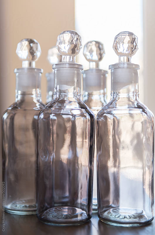 Decorative bottles on a shelf by Craig Holmes for Stocksy United