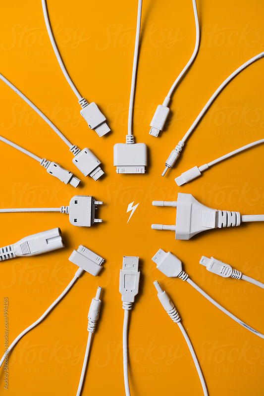 Various cable jacks and plugs on orange background by Marko Milanovic for Stocksy United