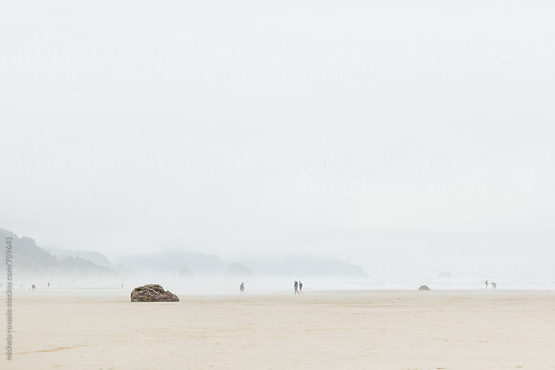 People walking on the Cannon Beach by michela ravasio for Stocksy United