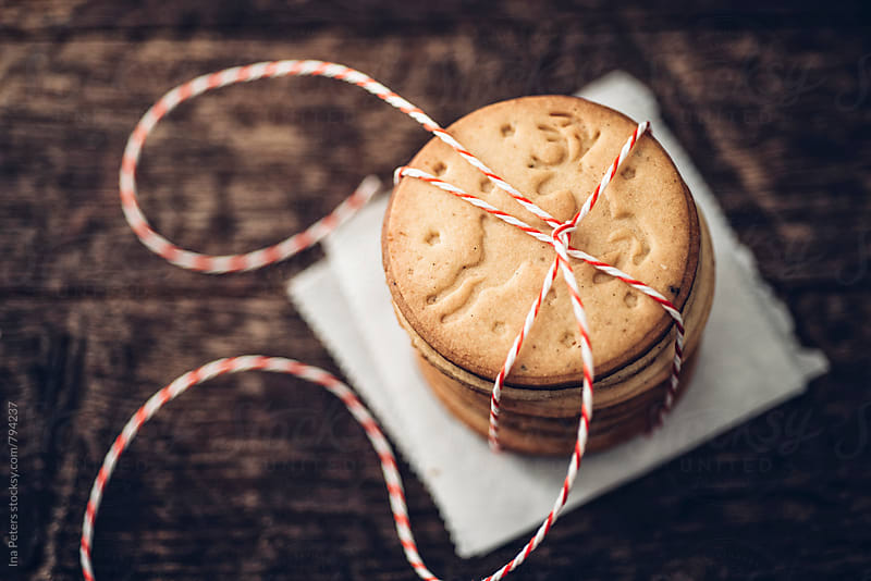 Food: Homemade stamped christmas cookies with reindeer by Ina Peters for Stocksy United