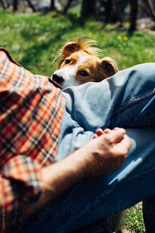 Elderly man with his dog by michela ravasio for Stocksy United