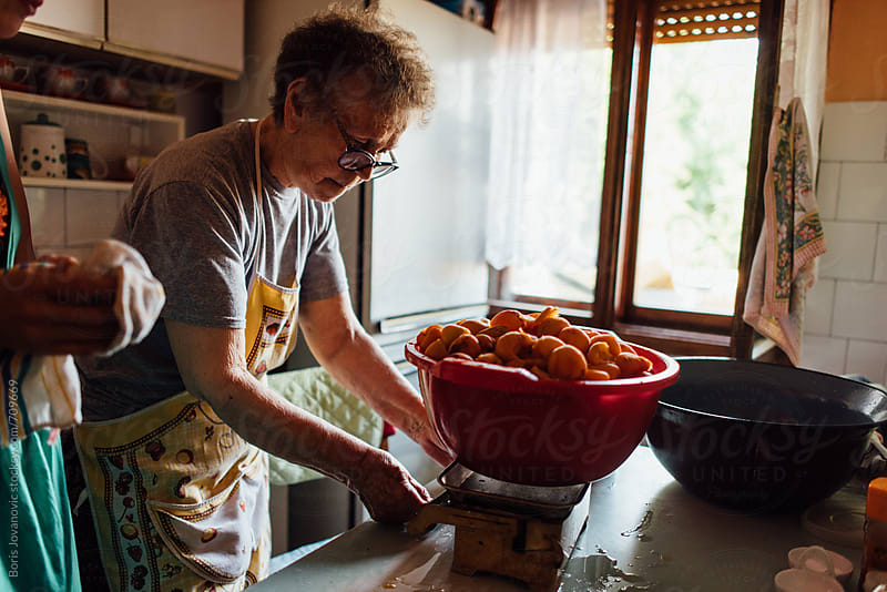 Senior woman preparing the apricot jam by Boris Jovanovic for Stocksy United