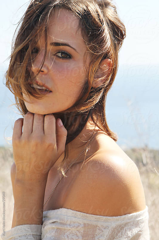 Young Women on Hillside with Ocean View by Kurt Heim for Stocksy United