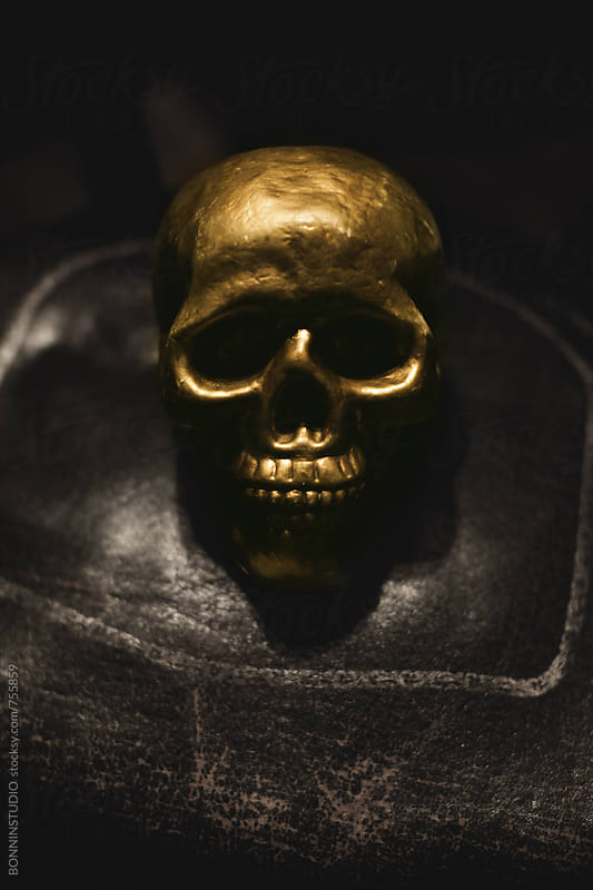Gold skull on a dark background. by BONNINSTUDIO for Stocksy United