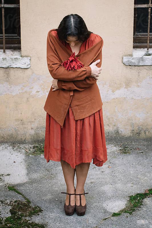 Portrait of a melancholic woman in autumn by Alberto Bogo for Stocksy United