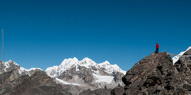 Male trekker looking out over snow capped peaks, Everest Region, Sagarmatha National Park, Nepal. by Thomas Pickard Photography Ltd. for Stocksy United