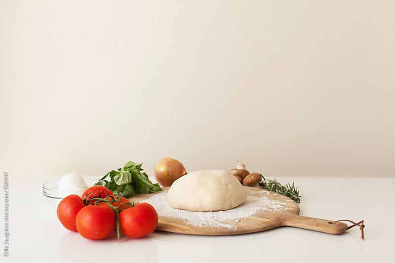 Pizza ingredients by Ellie Baygulov for Stocksy United