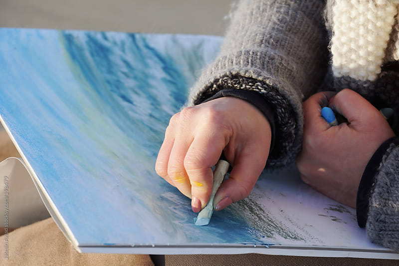Painting with soft oil crayons outdoors by Jasmin Awad for Stocksy United