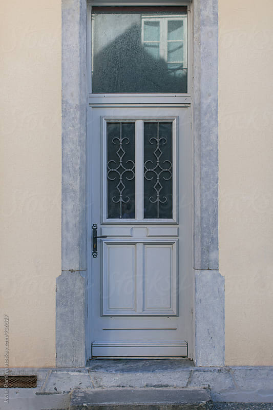 Detail of old door on typical french town by Javier Pardina for Stocksy United