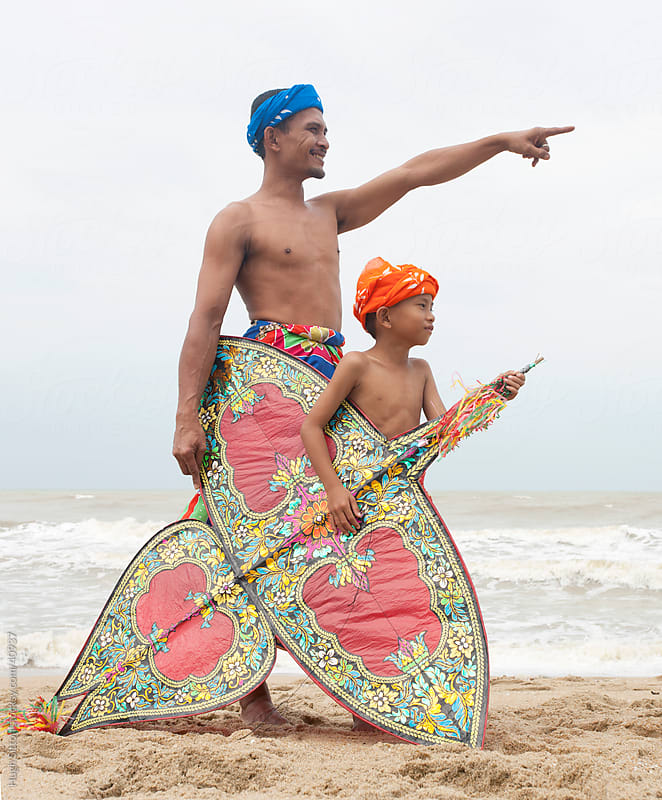 Father and Son with Kite. Malaysia by Hugh Sitton for Stocksy United