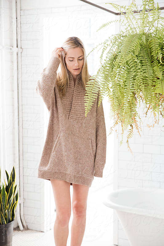 Woman in an oversize sweater  by Ivan Solis for Stocksy United