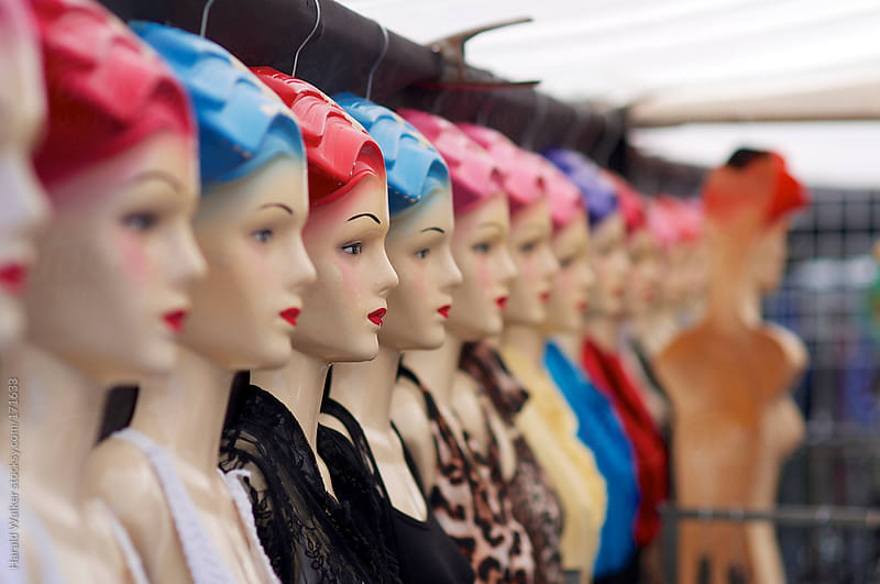 Mannequins with red and blue hair by Harald Walker for Stocksy United