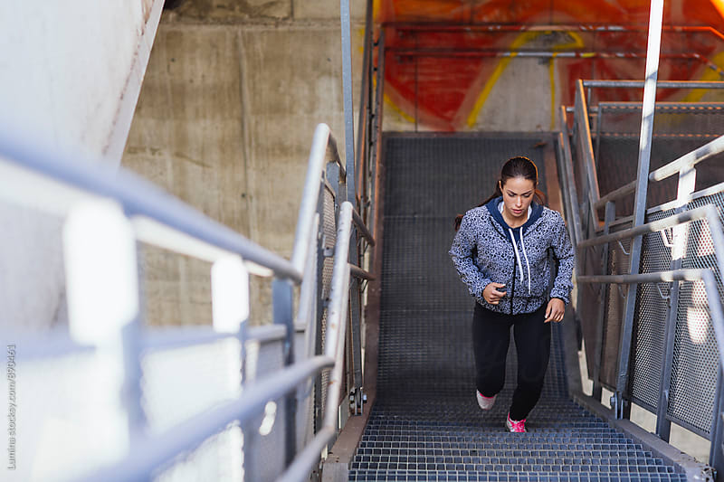 Woman Running Up the Stairs by Lumina for Stocksy United