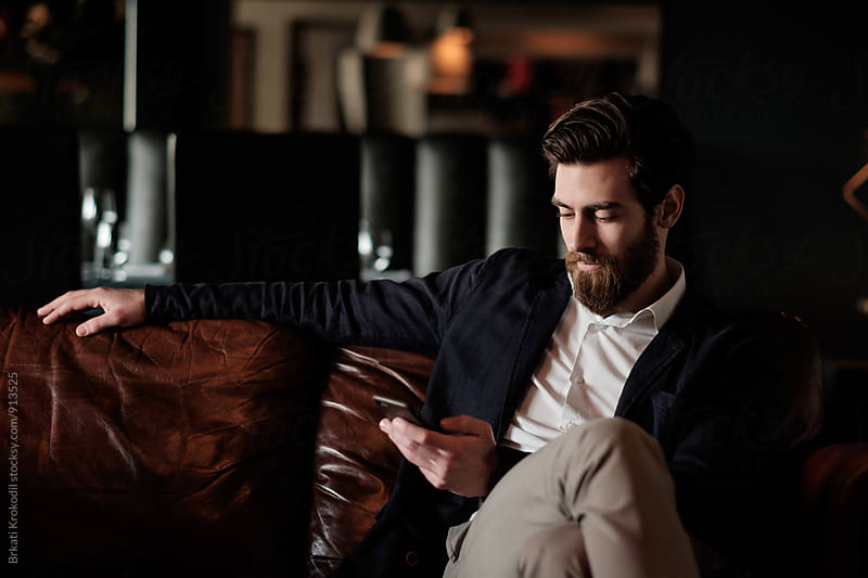 Handsome Bearded Man Using Phone by Branislav Jovanovic for Stocksy United