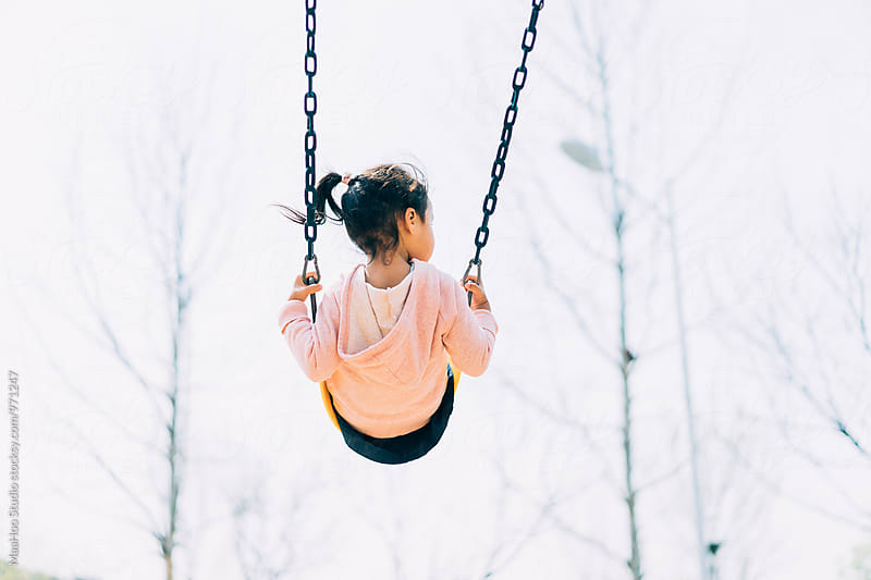 Girl playing on swing by Maa Hoo for Stocksy United
