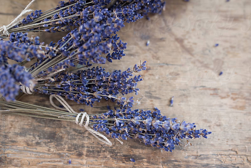 lavender on wooden table by Léa Jones for Stocksy United